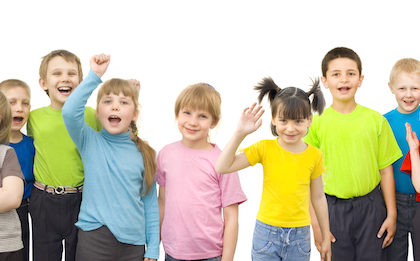 Children stand in a multicolored shirt with a white background